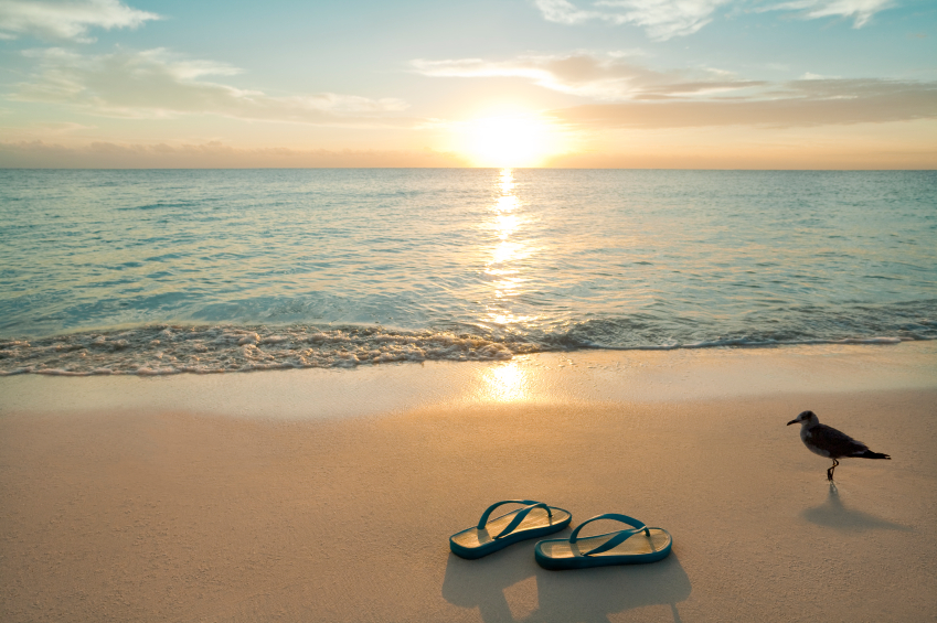Sunrise On Flip-Flops On The Beach